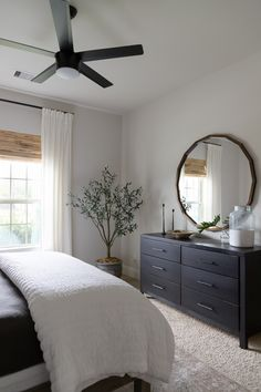 Neutral bedroom makeover with Bench*Made midtown dresser from Bassett furniture and faux olive tree