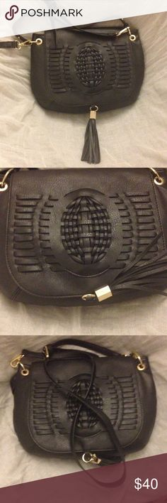 ✨Dolce Vita✨ Purse✨ Dolce vita purse, short handle and long, black, pretty design on front, tassel in front, inside has one inside pocket, no pockets in back. Dolce Vita Bags