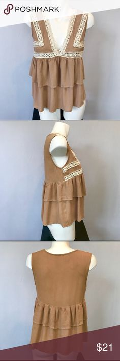 """ENTRO Boho Crochet Ruffle Top Blouse Tan Cream S Adorable Bohemian top from ENTRO. Crochet trim on bodice and front empire waist. Double Layer of Ruffles all around. Tan with Cream trim. Sleeveless. V-neck. Size Small. 100% rayon. Dry Clean. Approximate flat measurements: 19"""" bust, 23.5"""" length. Excellent condition. ENTRO Tops Blouses"""