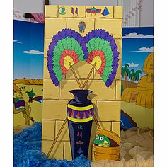 Can make Egyptian fans with crepe paper, tissue paper, and dowel rods that can be held and used rather than painting them on a fake wall.