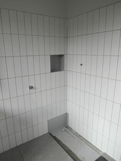 Bathroom wall tiles 300mm x 100mm gloss white in vertical format ready for grouting.