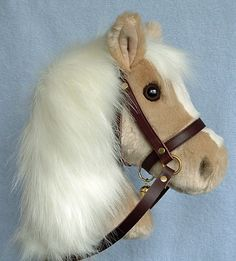 Palomino child's hobby horse made with super-soft fur fabric. It has a wooden handle, pole and wheels and a removable leather bridle with brass bell. Palomino, Crown Art, Dragons, Horse Mane, Stick Horses, Wooden Wheel, Horse Pattern, Hobby Horse, Horseshoe Projects