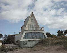 white A frame - cottage - summer months - blue skies - shelter