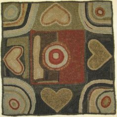 The talented Kris Miller hooked this adaption of the antique rug.