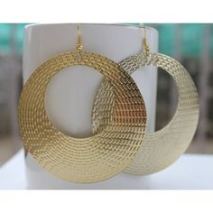 This is for the stylish young Indian woman .These are LARGE hoops & you need not wear any other piece of jewelery when you are sporting these ! The large hoops are in dull gold & have a pattern all over them.