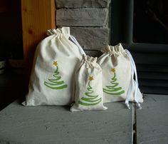 Set of 3 Christmas Reusable Gift Bags, Organic, Hemp, Unique, Hand-Painted by nikkidesigns on Etsy https://www.etsy.com/listing/36795850/set-of-3-christmas-reusable-gift-bags