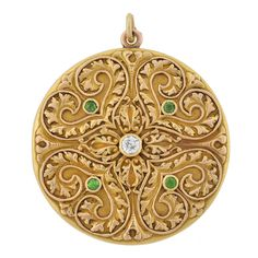 Victorian Demantoid Garnet & Diamond Locket. A stunning gold locket from the Late Victorian (ca1900) era! This beautiful piece is made of 14kt yellow gold and has a gorgeous raised applique design covering the entire front surface. Set in the center of the swirling heart design is a single 0.30ct old Mine Cut diamond which is surrounded by 4 vibrant green demantoid garnets, c 1880