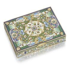 A silver-gilt and cloisonné enamel box, Konstantin Skvortsov, Moscow, 1908-1917 the lid centred with a foliate roundel in shaded polychrome enamels within flowerheads, leaf scrolls, grape clusters, cloison coils and bead trails on vari-coloured grounds, 84 standard width: 13cm, 5 1/8 in.