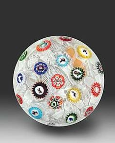 Antique Baccarat spaced concentric complex millefiori, with 10 Gridel silhouette canes on an upset muslin ground. Dated 1848. Diameter 3 inches.
