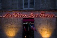 Neon of the Restaurant 'Au chien qui fume' in Paris, France