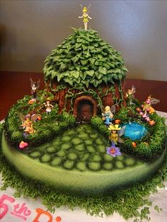 Tinkerbell cottage cake...Gracie's 2nd birthday theme is Tinkerbell...Wish I could find someone to do this.
