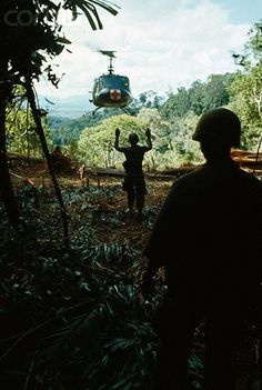 27 May 1967, Da Nang, South Vietnam --- With arms raised, a Marine signals a medical evacuation helicopter to take off from wooded area during Operation Union 2