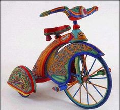 Beaded tricycle. Priceless?