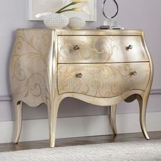 Metallic paint.  @Karla Looks like something we could do to the end tables.