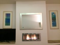 Essence ribbon gas fireplace with large mirror above. Above Fireplace Decor, Fireplace Wall, Gas Bill, Energy Use, Brick Building, Technical Drawing, Minimalism, Ribbon, Mirror