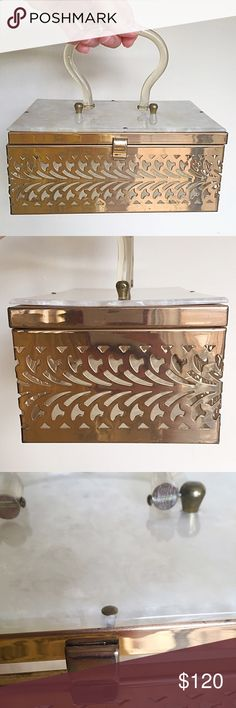 """1950s Vintage Reticulated Metal and Lucite Box Bag This is a Killer Mid Century box purse! Features Reticulated brass/brass like metal, pearly lucite bottom and lid, and clear lucite handle. In very good vintage condition. Clasp in working condition w/surface wear. General surface wear/finish loss present to metal. Some minor surface scratches to lucite. One back hinge is slightly bent but functions with no issues. Tiny 1/8"""" hair line crack to front and back nail on lid. Tiny piece of…"""
