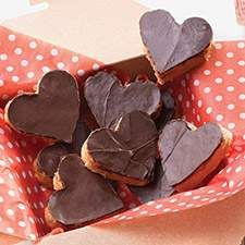 """This is one of those home recipes which emulates almost perfectly a store-bought treat: in this case, peanut butter cups. Sue Sulzer of Union, Maine, sent us this recipe long ago. Says Sue, """"These are really good. They keep indefinitely in the refrigerator, unless sweet teeth find them first."""" Thanks, Sue."""