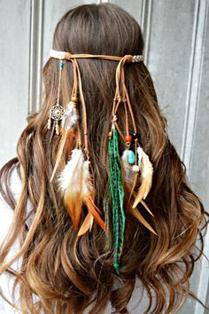 Feather headband, made with a gold dream catcher that is made with beads, feathers, and faux leather and cotton braided cord and elastic backing for