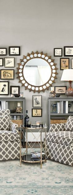 On this wall, a collection of dog prints are grouped together around a large mirror, and while they aren't perfectly symmetrical, there's a balance to them. To create this balance, you can put a large gourd lamp right up against the wall.