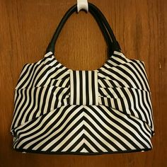 "Large Kate Spade bow bag Large Kate Spade bow bag. In like new condition. Black and white striped, cream colored interior with 2 pockets and zipper pocket. This one is canvas with leather straps. Zip top. Treated w stain protecter. Measures 8"" by 15"". Also has a leather bottom w gold studs. Dust bag and care card included. kate spade Bags"