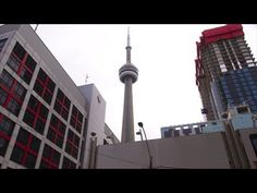 How to Do a Rotating Dolly Shot Around a 1,815 Foot Tall Building with Your DSLR