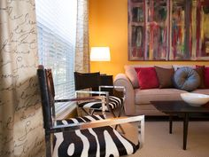 Living Room - Yellow walls, brown furniture, red/blue/green accents