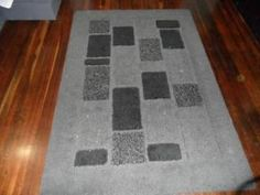Modern floor rug, good condition was $450 new.    Price: $80.00