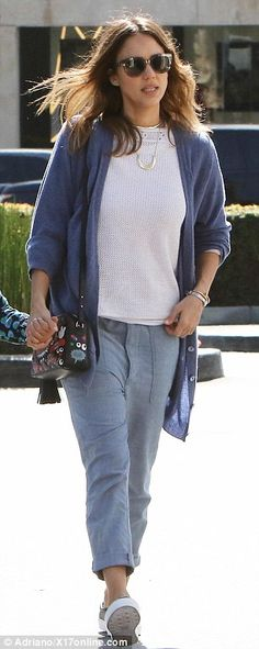 Fuss free: Jessicawas certainly dressed for comfort in cuffed linen harem trousers, a white knit top, blue cardigan, and black plimsolls