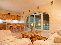 #holiday villa rental in gozo malta This newly built property is set in a quiet valley in Fontana which is on the outskirts of Gozo's capital Victoria. The entrance is through an old arched room with steps leading down to the property which is on one level. The property has 4 bedrooms all with en-suite facilities and also an additional small bedroom with bunk beds only suitable for children. │ #gozo gozovillarentals.com
