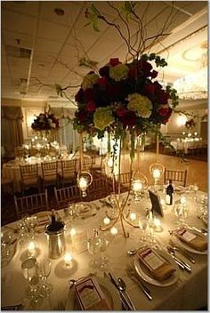 I like what how the table is set, ivory, candle light, wine/champagne.  I don't like the centerpiece though.