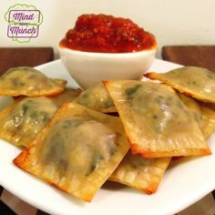 Ripped Recipes - Ravioli Bites - These Wonton Ravioli Bites are OFF THE CHARTS. Seriously. I set out some of my homemade pasta sauce on the side for dipping and it made a PERFECT appetizer or snack! I could have eaten them all day!!! I'll definitely be using these for a dinner party sometime! They are a bit tedious to assemble (as many wonton recipes are), but if you're a meticulous crafter like me then you'll have a blast!