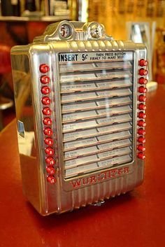 Jukebox, vending and slot machines. Jukebox, Vintage Slot Machines, Radios, In Wall Speakers, Music Machine, Counter Design, Industrial Machine, Music Hits, Wall Boxes