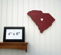"""South Carolina Gamecocks  """"State Heart"""" wall art, handcrafted wood with official team colors. $29.00, via Etsy."""