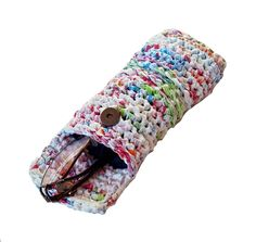 Eyeglass Case. Upcycled plastic bags, magnetic snap, acrylic button and lined with eyeglass cleaning cloths.