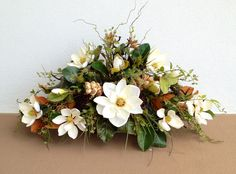 Magnolia mixed with natural color foliage, designed by Arcadia Floral and Home Decor.
