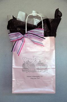 This #weddingwelcomebag is pink lemonade printed in charcoal ink. The skyline of Washington DC with the flag furled in the background is a perfect design for any couple getting married in our nation's Capitol.The sheer #organzaribbon of two pinks, white, silver and black stripe brings all the colors together. The #tissuepapers are silver crystal & black confetti. Visit www.FavorsYouKeep.com to see the hundreds of design options. Call us at 512.323.0600 -Austin,TX #washingtondcwedding