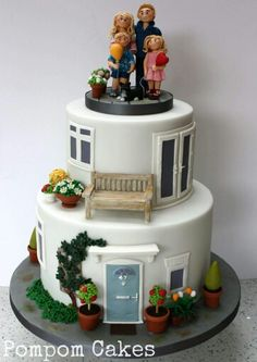 A cake for a couple celebrating their wedding anniversary, featuring the family and their cat on the top. The bottom tier was modelled on the front of the family house, and top tier was a replica of the back of the house, complete with their. Fancy Cakes, Cute Cakes, Beautiful Cakes, Amazing Cakes, Fondant Cakes, Cupcake Cakes, Building Cake, Building Front, Housewarming Cake