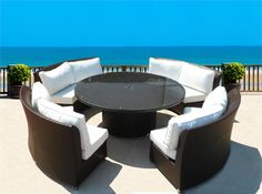 """Elegant round dining set with """"Lazy Susan"""" and Umbrella Hole.  Sofas double as  sectional seating for added versatility!  Many Color Choices Available!"""