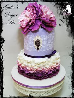 Purple wedding cake with brooch
