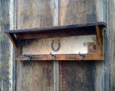 Cowhide horse shoe shelf.  Rustic, useful, & cute! I would love to have this in my master!