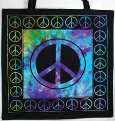 """Boldly displaying a peace sign, this black, cotton tote bag is accented by swirling tie-dye designs. Double sided. 18"""" x 18"""""""