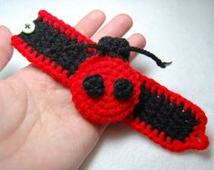 I designed the first ladybug bracelet during a road trip to keep my two-year-old quiet in her car seat. the idea was to give her something bright and colorful to play with that she could not easily throw onto the floor only to demand that it be returned to her. Lo and behold, it kept her busy in the car AND at the restaurant afterward!