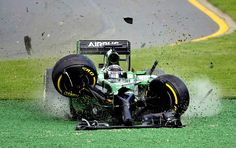 Caterham driver Kamui Kobayashi of Japan runs off the track after he crashed with Williams driver Felipe Massa of Brazil on the first lap of the Australian Formula One Grand Prix at Albert Park in Melbourne, Australia, Sunday, March 16, 2014. Both Massa and Kobayashi walked away from the accident. (AP Photo/Ross Land)/MEL111/666437996392/1403161410