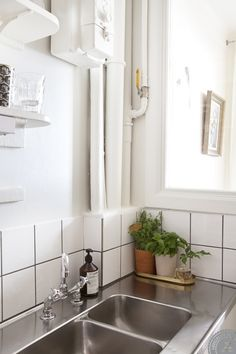 stainless steel and subway tile