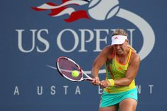Angelique Kerber of Germany returns a shot against Olga Govortsova of Belarus during their women's singles third round match on Day Six of the 2012 US Open