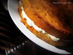Buttermilk Cake on glass cake plate in the sun BakeThisCake