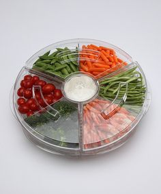 Iced Appetizer Tray & Lid Set. Fill the deep bottom of this tray with crushed or cubed ice and position the three food compartments above. Each section features a vented bottom to allow cold air to flow through, keeping food cool & crisp while an attractive dome keeps cold air in & bugs out $24.99 [Photo] http://mcdn.zulilyinc.com/images/cache/product//Prodyne/PRODYNE_AB_5_L1336795542.jpg