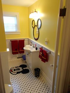 Original Pinner said: Our newly renovated Mickey Bathroom, I just love the mirror my husband designed and made!
