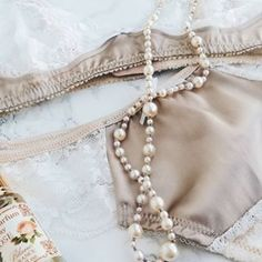 Close-up, Sandstone satin and lace lingerie. Lace Lingerie, Lace Bra, Satin Bra, Soft Bra, Pearls, Vintage, Jewelry, Fashion, Lace Playsuit