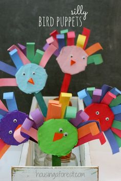 bird puppet craft  popsicle stick, circle of cardboard, curly paper